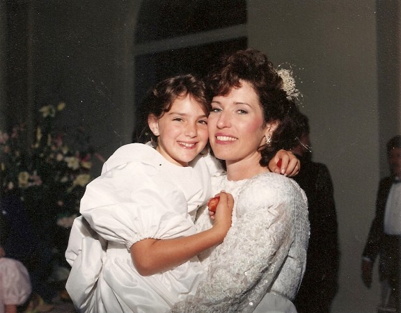 Lorrie holds Sara at our wedding reception on June 17, 1989